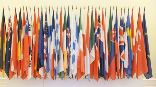 26 March 2014-Flags in entrance of OECD Chateau. OECD, Paris, France. Photo: OECD/Michael Dean